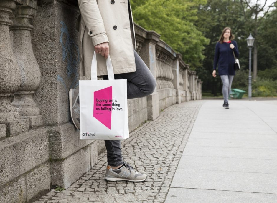 woman holding art'otel berlin mitte bag